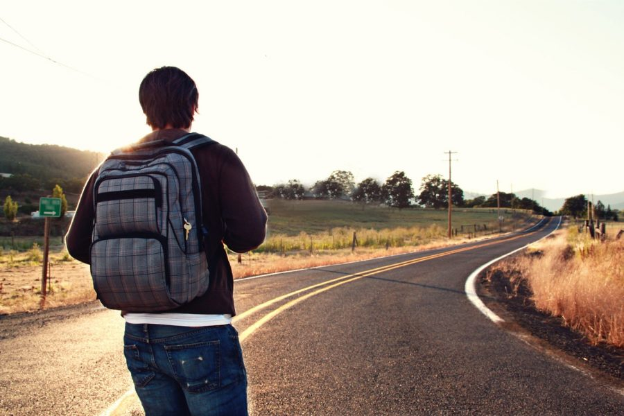 man with backpack on the road